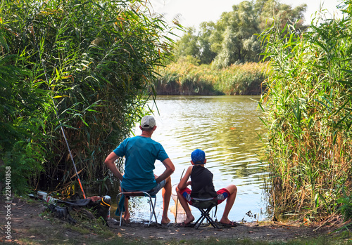 Foto op Canvas Vissen Dad And Son Fishing On the Lake.