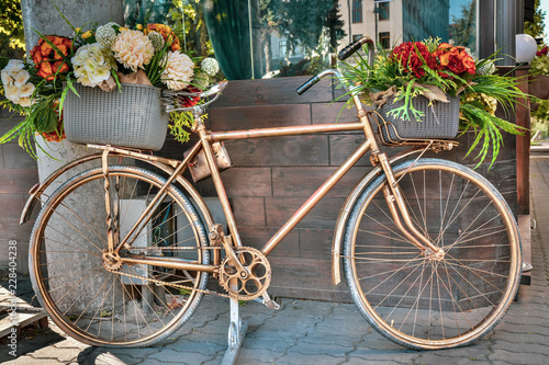 Old vintage bicycle decorated with flowers outdoors