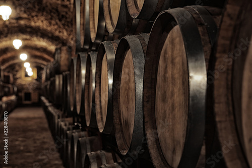 Valokuva Large wooden barrels in wine cellar, closeup