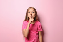 Little Girl In T-shirt Showing...