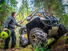 A Man In An All-terrain Vehicl...