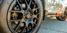 Black Tire Rim And Disc Brake Of A Shiny White Car