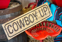 Western Decor With Cowboy Up Sign And Painted Red Vintage Tractor Seat