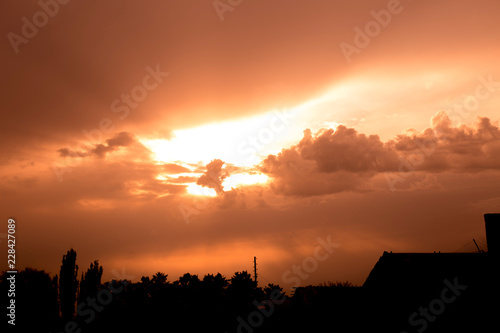 Photo Stands Cappuccino Sunset between the clouds