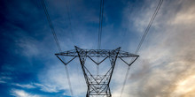 Electrical Tower Against A Dar...