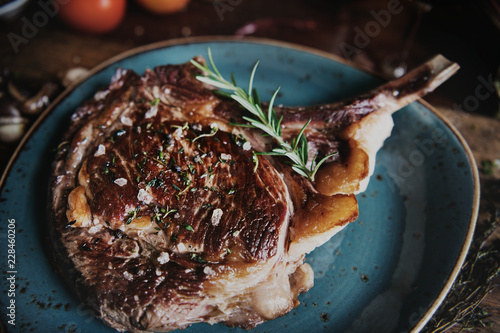 Tomahawk on a plate with garnish food photography recipe idea
