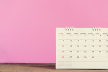 Close Up Of Calendar On The Table With Pink Background, Planning For Business Meeting Or Travel Planning Concept