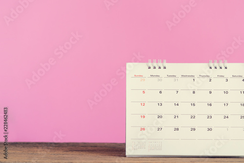 close up of calendar on the table with pink background, planning for business meeting or travel planning concept - 228462483