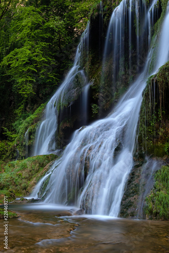 Deurstickers Watervallen French landscape - Jura. Waterfall in the Jura mountains after heavy rain.