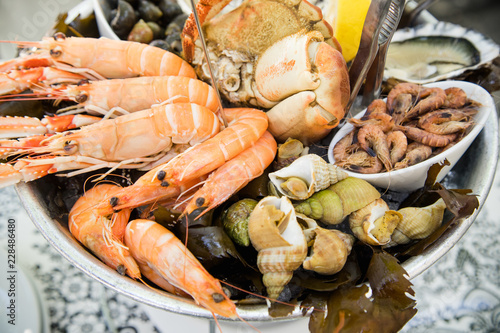 Plate with fresh assorted seafood in french summer restaurant Fototapet