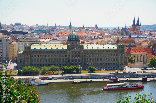 Fotografiet  View of Prague with Vltava and amazing buildings with red roofs