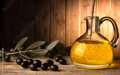 In de dag Aromatische bottle with olive oil on the wooden table