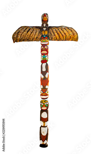 Colorful wooden totem pole. Isolated on white background. Path included. Wall mural