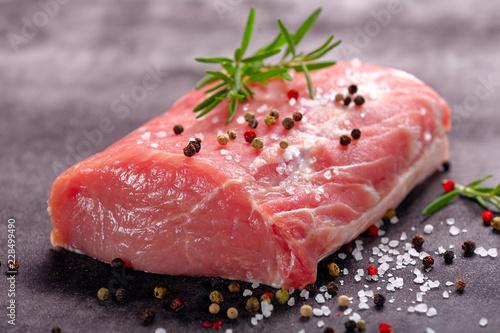 Raw portion of pork chop on a stone background Canvas Print