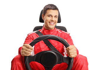 Smiling car racer holding a steering wheel