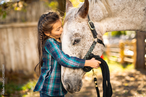 Fotografie, Obraz  in a beautiful Autumn season of a young girl and horse