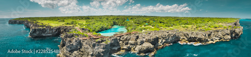 Montage in der Fensternische Luftaufnahme Aerial drone shot green-capped island, ocean. Panorama. Indonesia. Spectacular view from above Sumba island the plain with greens and pure lakes on the blue cloudy sky background. Indian ocean.