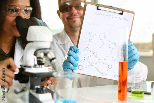 Photo  Two scientists of a student chemist are conducting