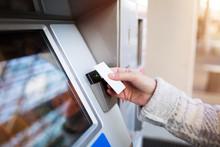 Woman Purchasing Fare For Public Transit