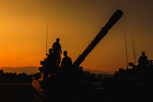 Silhouette Of Soldier At Sunset