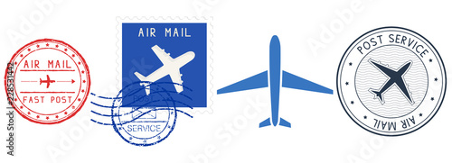Fotografía  Postmarks. Colored set of postal elements with airplane signs