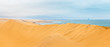 canvas print picture - Long yellow sand dune of Kalahari desert and Atlantic ocean shore, with oil rigs and ships on the horizon,close to Swakopmund town, Namibia