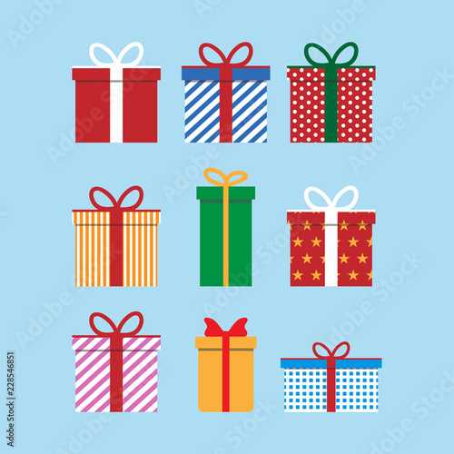 Fototapeta Set of colorful icons of gift boxes. Flat design for Christmas present, love valentine present on blue background. Vector illustration. obraz