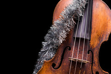 A Viola Or Violin With A Christmas Ornament On A Black Background