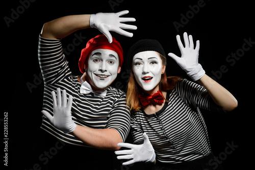 Fotografie, Obraz  Smiling mimes in striped shirts