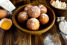 Homemade Cottage Cheese Donuts And Ingredients On The Brown Wooden Background
