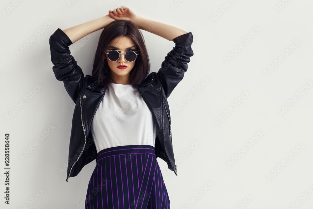 Fototapety, obrazy: Fashion portrait of a young woman in leather jacket.