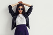 Leinwandbild Motiv Fashion portrait of a young woman in leather jacket.