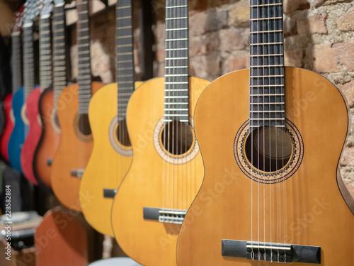 Spoed Foto op Canvas Muziekwinkel a row of acoustic guitars at music store