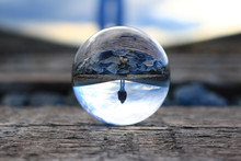 Refection Of A Woman Walking O...
