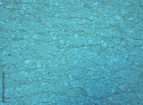 Vászonkép light blue turquoise stone texture with a cracked irregular granular textured su