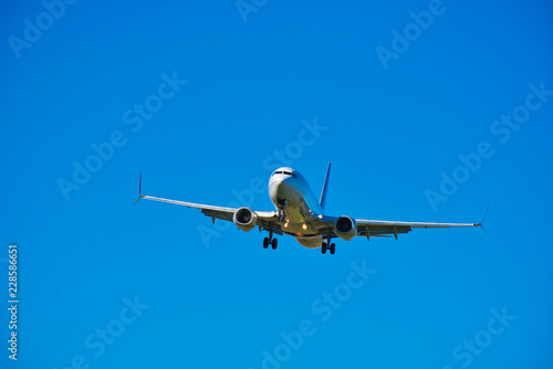 Photo  Boeing 737 Commercial Jet Flight - Civilian Jet Aircraft Landing - Deep Blue Sky