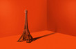 canvas print picture - Eiffel tower in an orange room. Minimalistic concept, travel and sightseeing. A metal statue of the Eiffel Tower on a strong orange background.