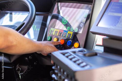 a bus driver push a button in a bus