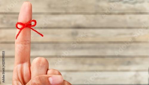 Obraz Rope bow on finger pointing up on - fototapety do salonu
