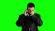 Young Businessman Getting Bad News Cell Phone Greenscreen