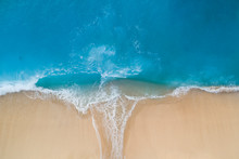 Aerial View Of Turquoise Sea And Sandy Shore