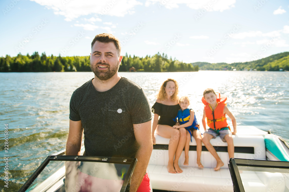 Fototapety, obrazy: Man driving boat on holiday with his son kids and his wife