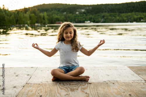 child girl Yoga relax in pier at the sunset