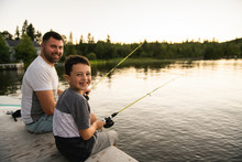 Cool Dad And Son Fishing On Lake