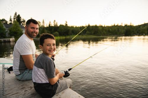 Fotobehang Vissen Cool Dad and son fishing on lake