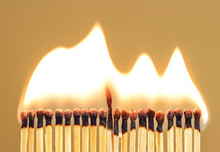 Burning Match Among Others On Isolated Background. Difference And Uniqueness Concept