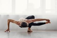 Strong Flexible Man Doing Morning Yoga Exercises