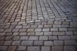 Background of Asymmetric Cobblestone Road Cobblestones in old centre of Berlin
