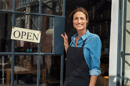 Woman at small business entrance Canvas Print