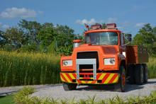 Old Orange Color Retro Truck In A Field